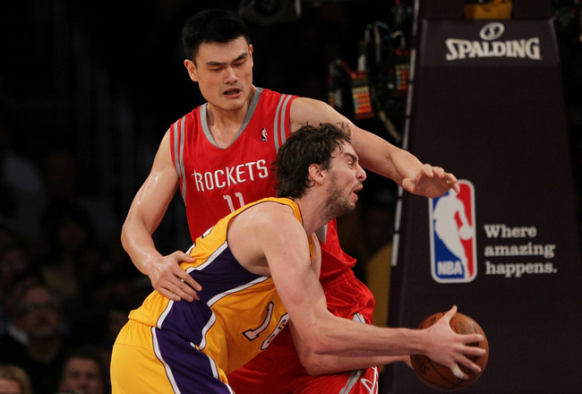 LOS ANGELES, CA - OCTOBER 26:  Pau Gasol #16 of the Los Angeles Lakers looks to score as Yao Ming #11 of the Houston Rockets defends during their NBA game at Staples Center on October 26, 2010 in Los Angeles, California. NOTE TO USER: User expressly ackno