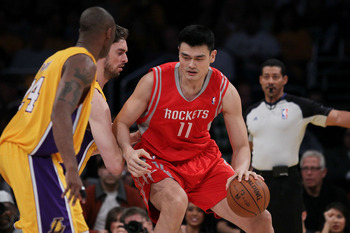 LOS ANGELES, CA - OCTOBER 26:  Pau Gasol #16 of the Los Angeles Lakers defends as Yao Ming #11 of the Houston Rockets controls the ball during their NBA game at Staples Center on October 26, 2010 in Los Angeles, California. NOTE TO USER: User expressly ac