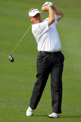 HONG KONG - NOVEMBER 19: Colin Montgomerie of Scotland plays his 2nd shot on the 3rd hole during day two of the UBS Hong Kong Open at The Hong Kong Golf Club on November 19, 2010 in Hong Kong, Hong Kong. ( Photo By : Stanley Chou/Getty Images )