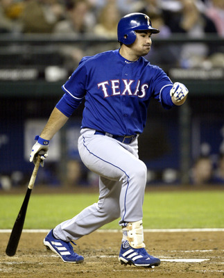 SEATTLE - SEPTEMBER 27:  Adrian Gonzalez #24 of the Texas Rangers singles in the fifth inning against the Seattle Mariners on September 27, 2005 at Safeco Field in Seattle, Washington.  (Photo by Otto Greule Jr/Getty Images)
