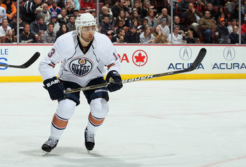 ANAHEIM, CA - NOVEMBER 21:  Andrew Cogliano #13 of the Edmonton Oilers skates against the Anaheim Ducks at the Honda Center on November 21, 2010 in Anaheim, California.  (Photo by Jeff Gross/Getty Images)