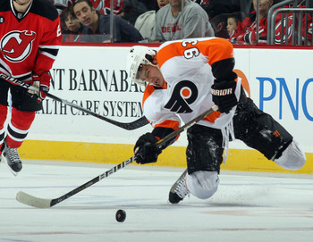 NEWARK, NJ - NOVEMBER 27: Nikolay Zherdev #93 of the Philadelphia Flyers struggles to maintain control of the puck in his game against the New Jersey Devils at the Prudential Center on November 27, 2010 in Newark, New Jersey.  (Photo by Bruce Bennett/Gett