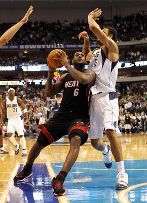 DALLAS - NOVEMBER 27: LeBron James #6 of the Miami Heat drives by Tyson Chandler #6 of the Dallas Mavericks on November 27, 2010 at the American Airlines Center in Dallas, Texas. NOTE TO USER: User expressly acknowledges and agrees that, by downloading an