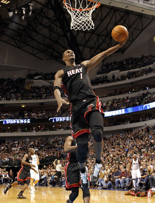 DALLAS - NOVEMBER 27: Chris Bosh #1 of the Miami Heat dunks on the Dallas Mavericks  on November 27, 2010 at the American Airlines Center in Dallas, Texas. NOTE TO USER: User expressly acknowledges and agrees that, by downloading and or using this Photogr