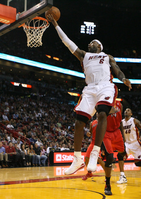 MIAMI - NOVEMBER 13:  Forward LeBron James #6 of the Miami Heat scores against the Toronto Raptors at American Airlines Arena on November 13, 2010 in Miami, Florida. NOTE TO USER: User expressly acknowledges and agrees that, by downloading and or using th