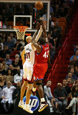 MIAMI - NOVEMBER 26:  Center Zydrunas Ilgauskas #11 of the Miami Heat defends against Forward Elton Brand #42 of the Philadelphia 76ers at American Airlines Arena on November 26, 2010 in Miami, Florida. The Heat defeated the 76ers 99-90.  (Photo by Marc S