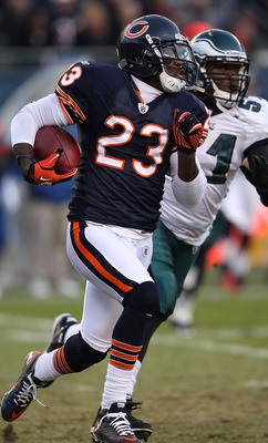 CHICAGO - NOVEMBER 28: Devin Hetser #23 of the Chicago Bears returns a kick pursued by Jamar Chaney #51 of the Philadelphia Eagles at Soldier Field on November 28, 2010 in Chicago, Illinois. The Bears defeated the Eagles 31-26. (Photo by Jonathan Daniel/G