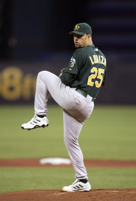 MINNEAPOLIS, MN - OCTOBER 4: Starting pitcher Esteban Loaiza #25 of the Oakland Athletics delivers the ball against the Minnesota Twins in game two of the American League Division Series at the Hubert H. Humphrey Metrodome on October 04, 2006 in Minneapol