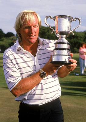 MELBOURNE, AUSTRALIA - 1988:  Greg Norman of Australia holds aloft the winners trophy after winning the Golf Championships 1988 in Melbourne, Australia. Norman is a professional golfer and entrepreneur who spent 331 weeks as the world's number one ranked
