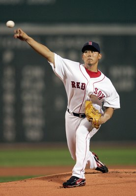 BOSTON - JULY 19: Daisuke Matsuzaka #18 of the Boston Red Sox delivers a pitch in the first inning against the Chicago White Sox on July 19, 2007 at Fenway Park in Boston, Massachusetts. (Photo by Elsa/Getty Images)