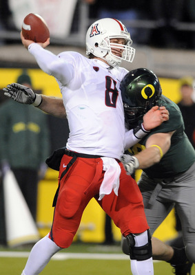 EUGENE, OR - NOVEMBER 26: Defensive end Brandon Bair #88 of the Oregon Ducks hits quarterback Nick Foles #8 of the Arizona Wildcats in the fourth quarter of the game at Autzen Stadium on November 26, 2010 in Eugene, Oregon. The Ducks won the game 48-29. (