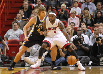 MIAMI - NOVEMBER 09:  Lebron James #6 of the Miami Heat fights for position with Andrei Kirilenko #47 during a game against the Utah Jazz at American Airlines Arena on November 9, 2010 in Miami, Florida. NOTE TO USER: User expressly acknowledges and agree