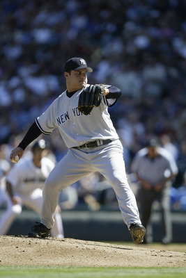 SEATTLE - SEPTEMBER 1:  Jaret Wright #33 of the New York Yankees pitches during the game with the Seattle Mariners on September 1 2005 at Safeco Field in Seattle Washington. The Mariners won 5-1.  (Photo by Otto Greule Jr/Getty Images)