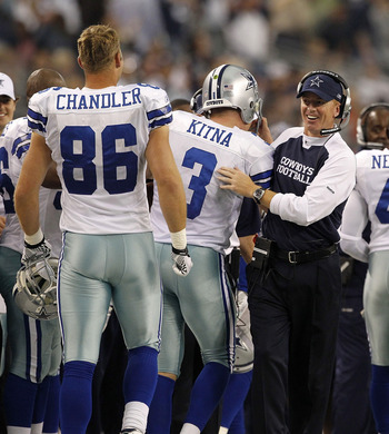 ARLINGTON, TX - NOVEMBER 21:  Dallas Cowboys interim head coach Jason Garrett congratulates Jon Kitna #3 after his 29 yard fourth quarter touchdown against the Detroit Lions during the game at Dallas Stadium on November 21, 2010 in Arlington, Texas. The C