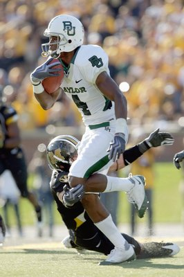 COLUMBIA, MO - NOVEMBER 7: David Gettis #4 of the Baylor Bears carries the ball during the game against the Missouri Tigers at Faurot Field at Memorial Stadium on November 7, 2009 in Columbia, Missouri. (Photo by Jamie Squire/Getty Images)