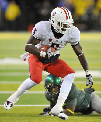 EUGENE, OR - NOVEMBER 26: Running back Nic Grigsby #5 of the Arizona Wildcats runs with the ball in the second quarter of the game against the Oregon Ducks at Autzen Stadium on November 26, 2010 in Eugene, Oregon. (Photo by Steve Dykes/Getty Images)