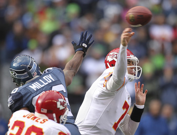 SEATTLE - NOVEMBER 28:  Quarterback Matt Cassel #7 of the Kansas City Chiefs passes against Lawyer Milloy #36 of the Seattle Seahawks at Qwest Field on November 28, 2010 in Seattle, Washington. (Photo by Otto Greule Jr/Getty Images)