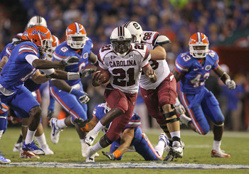 GAINESVILLE, FL - NOVEMBER 13:  Marcus Lattimore #21 of the South Carolina Gamecocks rushes during a game against the Florida Gators at Ben Hill Griffin Stadium on November 13, 2010 in Gainesville, Florida.  (Photo by Mike Ehrmann/Getty Images)