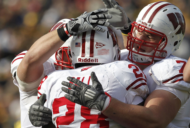 ANN ARBOR, MI - NOVEMBER 20:  Montee Ball #28 of the Wisconsin Badgers celebrates a second quarter touchdown with teammate Kevin Zeitler #70 while playing the Michigan Wolverines at Michigan Stadium on November 20, 2010 in Ann Arbor, Michigan.  (Photo by