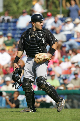 VERO BEACH, FL - MARCH 2:  Catcher Paul Lo Duca #16 of the Florida Marlins looks on against the Los Angeles Dodgers during MLB Spring Training on March 2, 2005 at Holman Stadium in Vero Beach, Florida. The Dodgers defeated the Marlins 4-2.  (Photo by Rona