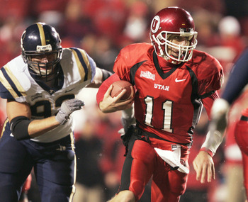 SALT LAKE CITY, UT - NOVEMBER 20: Quarterback Alex Smith #11 of the University of Utah scrambles for a first down as John Denney #92 of BYU gives chase during the second quarter November 20, 2004 at Rice Eccles Stadium in Salt Lake City, Utah. (Photo by G