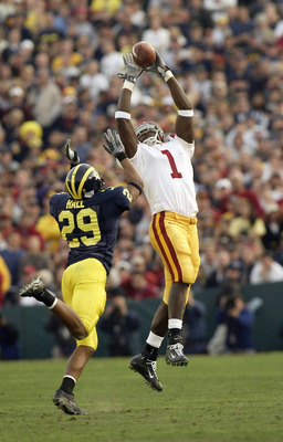 PASADENA, CA - JANUARY 1:  Wide receiver Mike Williams #1 of the USC Trojans makes a catch in front of cornerback Leon Hall of the Michigan Wolverines in the 2004 Rose Bowl on January 1, 2004 at the Rose Bowl in Pasadena, California. USC defeated Michigan