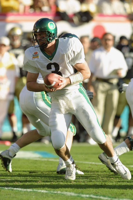 01 Jan 2002 : Quarterback Joey Harrington of Oregon looks for an opening against Colorado during the game at the  Fiesta Bowl at Sun Devil Stadium in Tempe, Arizona. The Oregon Ducks won 38-16. DIGITAL IMAGE. Mandatory Credit: Jeff Gross/Getty Images