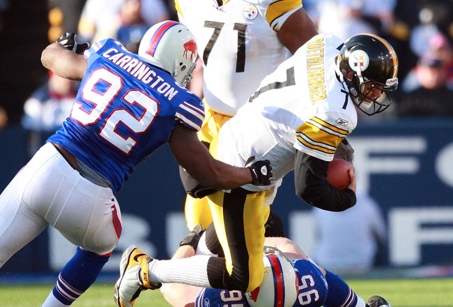 ORCHARD PARK, NY - NOVEMBER 28:  Ben Roethlisberger #7 of the Pittsburgh Steelers is sacked by Alex Carrington #92 and Kyle Williams #95 of the Buffalo Bills at Ralph Wilson Stadium on November 28, 2010 in Orchard Park, New York.  (Photo by Karl Walter/Ge