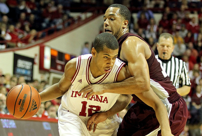 BLOOMINGTON, IN - NOVEMBER 23: Verdell Jones #12 of the Indiana Hoosiers dribbles the ball while defended by Connell Wilkerson #12 of the North Carolina Central Eagles at Assembly Hall on November 23, 2010 in Bloomington, Indiana.  Indiana won 72-56.  (Ph