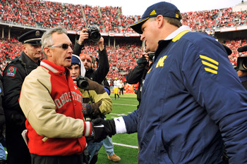 COLUMBUS, OH - NOVEMBER 27:  Head Coach Jim Tressel of the Ohio State Buckeyes shakes hands with Head Coach Rich Rodriguez after the Buckeyes defeated the Wolverines 37-7 at Ohio Stadium on November 27, 2010 in Columbus, Ohio.  (Photo by Jamie Sabau/Getty