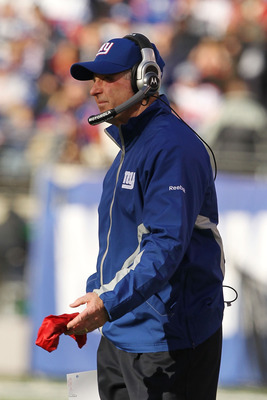 EAST RUTHERFORD, NJ - NOVEMBER 28:  New York Giants Head Coach Tom Coughlin throws the red challenge flag in the first quarter against the Jacksonville Jaguars on November 28, 2010 at The New Meadowlands Stadium in East Rutherford, New Jersey.  (Photo by