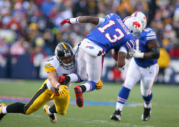 ORCHARD PARK, NY - NOVEMBER 28:  Steve Johnson #13 of the Buffalo Bills is tackled James Farrior #51 of the Pittsburgh Steelers at Ralph Wilson Stadium at Ralph Wilson Stadium on November 28, 2010 in Orchard Park, New York.Pittsburgh won 19-16 in overtime