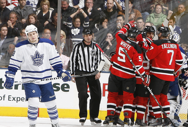 TORONTO - NOVEMBER 18: John Mitchell #39 of the Toronto Maple Leafs skates away as the New Jersey Devils celebrate goal during game action at the Air Canada Centre November 18, 2010 in Toronto, Ontario, Canada. (Photo by Abelimages/Getty Images)