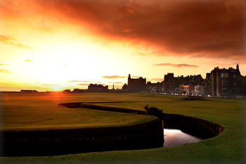 ST ANDREWS, UNITED KINGDOM - AUGUST 29:  The sun rises behind the R&A Clubhouse on the par 4, 18th hole 'Tom Morris' on the Old Course at St Andrews on August 29, 2009 in St Andrews, Scotland  (Photo by David Cannon/Getty Images)