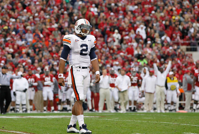 TUSCALOOSA, AL - NOVEMBER 26:  Quarterback Cam Newton #2 of the Auburn Tigers looks to the sidelines for a play call against the Alabama Crimson Tide at Bryant-Denny Stadium on November 26, 2010 in Tuscaloosa, Alabama.  (Photo by Kevin C. Cox/Getty Images