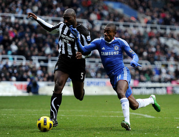 NEWCASTLE, UNITED KINGDOM - NOVEMBER 28:  Sol Campbell of Newcastle United battles for the ball with Salomon Kalou of Chelsea during the Barclays Premier League match between Newcastle United and Chelsea at St James' Park on November 28, 2010 in Newcastle