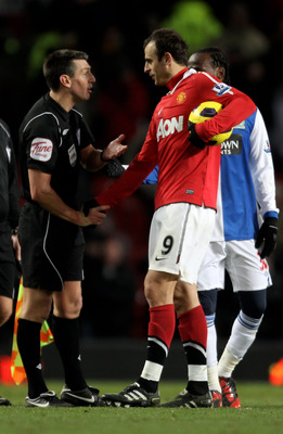 MANCHESTER, ENGLAND - NOVEMBER 27:  Dimitar Berbatov of Manchester United shakes hands with Referee Lee Probert at the end of the Barclays Premier League match between Manchester United and Blackburn Rovers at Old Trafford on November 27, 2010 in Manchest