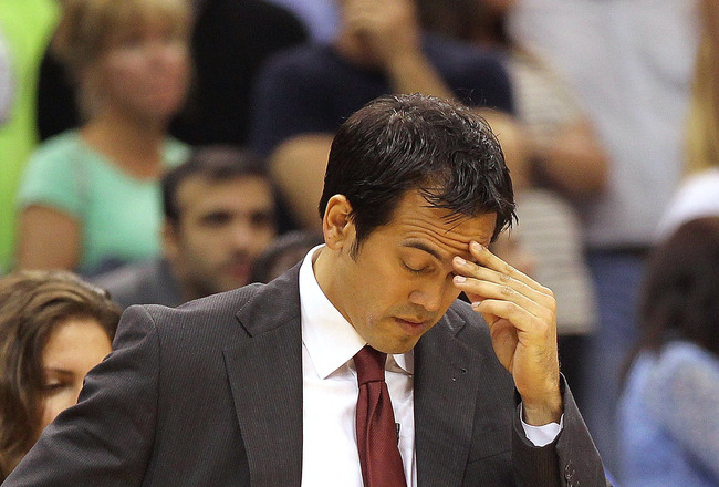ORLANDO, FL - NOVEMBER 24:  Miami Heat head coach Erik Spoelstra reacts during a game against the Orlando Magic at Amway Arena on November 24, 2010 in Orlando, Florida. NOTE TO USER: User expressly acknowledges and agrees that, by downloading and/or using