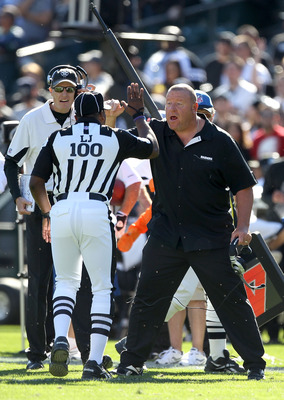 OAKLAND, CA - OCTOBER 31:  Head coach Tom Cable of the Oakland Raiders argues with field judge Tom Symonette during their game against the Seattle Seahawks at Oakland-Alameda County Coliseum on October 31, 2010 in Oakland, California.  (Photo by Ezra Shaw