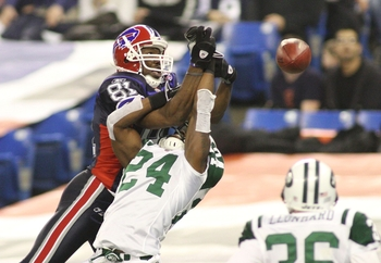 TORONTO - DECEMBER 3: Darrelle Revis #24 of the New York Jets breaks up a pass intended for Terrell Owens #81 of the Buffalo Bills at Rogers Centre on December 3, 2009 in Toronto, Canada.  (Photo by Rick Stewart/Getty Images)