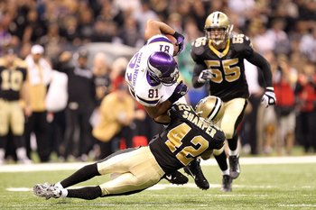 NEW ORLEANS - JANUARY 24:  Visanthe Shiancoe of #81 the Minnesota Vikings is tackled on a reception by Darren Sharper #42 of the New Orleans Saints during the NFC Championship Game at the Louisiana Superdome on January 24, 2010 in New Orleans, Louisiana.