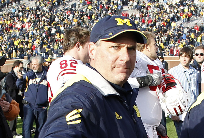 ANN ARBOR, MI - NOVEMBER 20: Head coach Rich Rodriguez of the Michigan Wolverines leaves the field after losing 28-48 to the Wisconson Badgers at Michigan Stadium on November 20, 2010 in Ann Arbor, Michigan.  (Photo by Gregory Shamus/Getty Images)