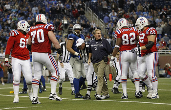 DETROIT - NOVEMBER 25:  New England Patriots head coach Bill Belichick breaks up a late fourth quarter scuffle between the Lions and the Patriots during the game at Ford Field on November 25, 2010 in Detroit, Michigan. New England defeated Detroit 45-24.