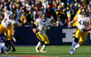 ORCHARD PARK, NY - NOVEMBER 28:  Ben Roethlisberger #7 of the Pittsburgh Steelers runs with protection from Maurkice Pouncey #53 and Chris Kemoteatu #68 against the Buffalo Bills at Ralph Wilson Stadium at Ralph Wilson Stadium on November 28, 2010 in Orch