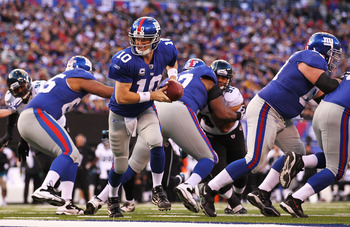 EAST RUTHERFORD, NJ - NOVEMBER 28:  Eli Manning #10 of the New York Giants looks to hand the ball off during the game against  the Jacksonville Jaguars on November 28, 2010 at The New Meadowlands Stadium in East Rutherford, New Jersey.  (Photo by Al Bello