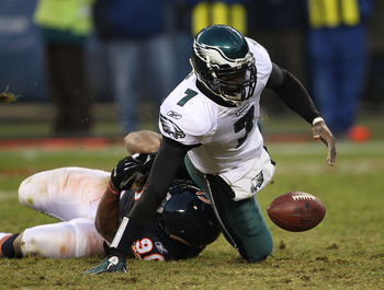 CHICAGO - NOVEMBER 28: Michael Vick #7 of the Philadelphia Eagles fumbles the ball as he is sacked by Julius Peppers #90 of the Chicago Bears at Soldier Field on November 28, 2010 in Chicago, Illinois.  (Photo by Jonathan Daniel/Getty Images)