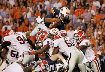 AUBURN, AL - NOVEMBER 13:  Quarterback Cameron Newton #2 of the Auburn Tigers dives across the defense for a touchdown against the Georgia Bulldogs at Jordan-Hare Stadium on November 13, 2010 in Auburn, Alabama.  (Photo by Kevin C. Cox/Getty Images)