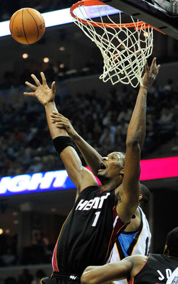 MEMPHIS, TN - NOVEMBER 20:  Chris Bosh #1 of the Miami Heat battles for a rebound against the Memphis Grizzlies at FedExForum on November 20, 2010 in Memphis, Tennessee. The Grizzlies won 97-95.  NOTE TO USER: User expressly acknowledges and agrees that,
