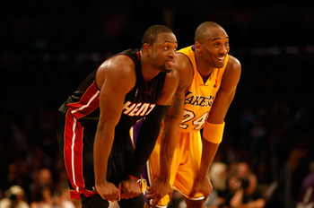 LOS ANGELES, CA - DECEMBER 04:  Kobe Bryant #24 of the Los Angeles Lakers and Dwayne Wade #3 of the Miami Heat share a laugh in the fourth quarter at Staples Center on December 4, 2009 in Los Angeles, California. The Lakers defeated the Heat 108-107. NOTE