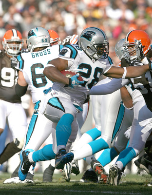 CLEVELAND - NOVEMBER 28:  Running back Jonathan Stewart #28 of the Carolina Panthers runs by linebacker Chris Gocong #51 of the Cleveland Browns at Cleveland Browns Stadium on November 28, 2010 in Cleveland, Ohio.  (Photo by Matt Sullivan/Getty Images)